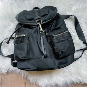 Calvin Klein Talia Nylon Black and Gold Drawstring Logo Print Backpack NWT